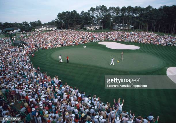 Scottish golfer Sandy Lyle celebrates with his caddy Dave Musgrove after winning the US Masters Golf Tournament at the Augusta National Golf Club in...