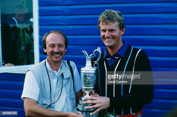 Scottish golfer Sandy Lyle poses with sports photographer Phil Sheldon after winning the British Open at Royal St George's Golf Club July 1985