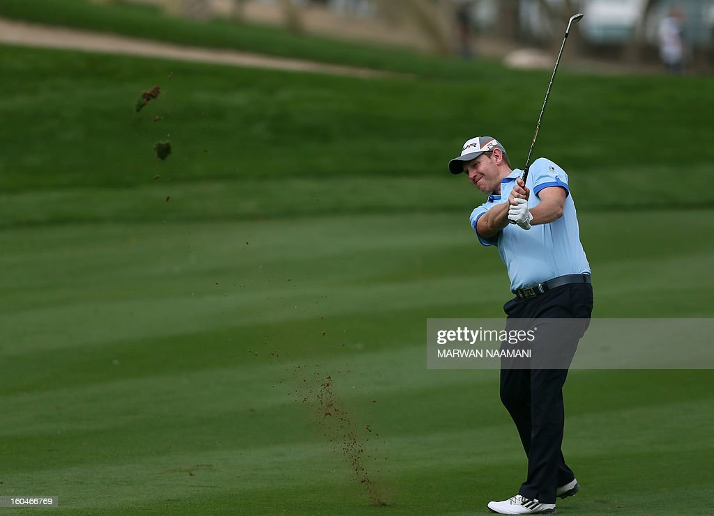 Scottish golfer Stephen Gallacher plays a shot during the second round of the Dubai Desert Classic golf tournament in the Gulf emirate of Dubai on February 1, 2013.