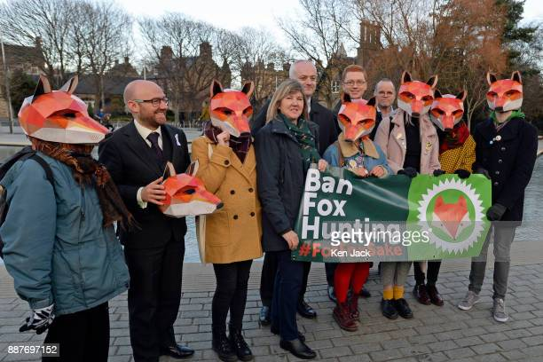 Scottish Green Party MSP Alison Johnstone other Green MSPs and supporters wear mock fox heads outside the Scottish Parliament as she launched an...