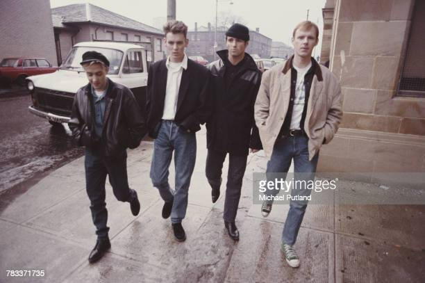 Scottish group Wet Wet Wet pictured walking along a street in Glasgow Scotland in 1987 The group are from left Neil Mitchell Graeme Clark Marti...