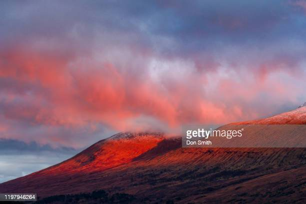 scottish highland hills and alpenglow - don smith stock pictures, royalty-free photos & images