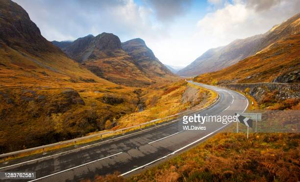 scottish highlands road - atmospheric mood stock pictures, royalty-free photos & images