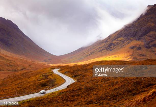 scottish highlands road - driving stock pictures, royalty-free photos & images