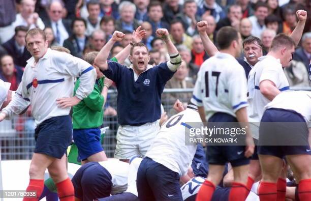 Scottish hooker Gordon Bulloch jubilates as French ní8 Christophe Juillet looks dejected at the end of the France/Scotland Five Nations rugby match...