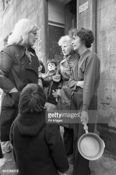 Scottish housewives discuss local problems with Scottish National Party candidate for Govan Glasgow Margo MacDonald during her tour of the area Mrs...