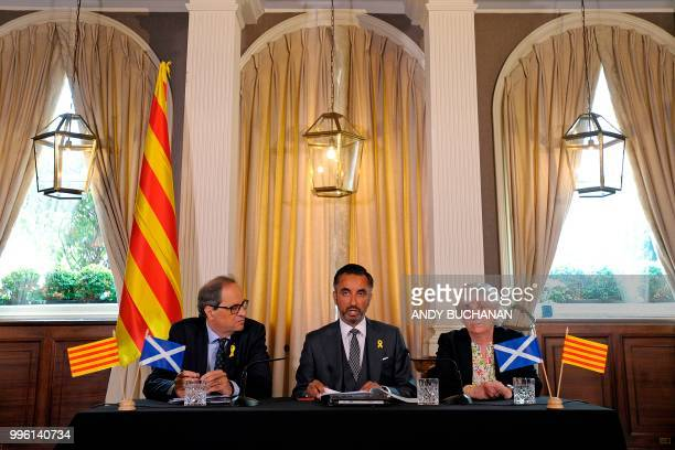 Scottish human rights lawyer Aamer Anwar is flanked by former Catalan education minister Clara Ponsati and Calatan President Quim Torra at a press...