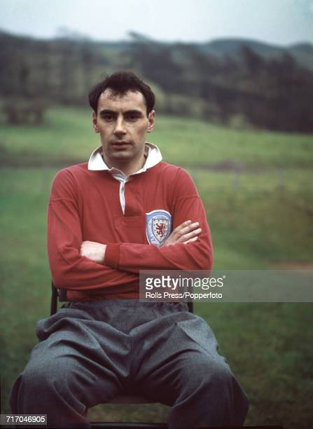 Scottish international footballer and striker with Tottenham Hotspur FC Alan Gilzean posed prior to a training session with the national side in...