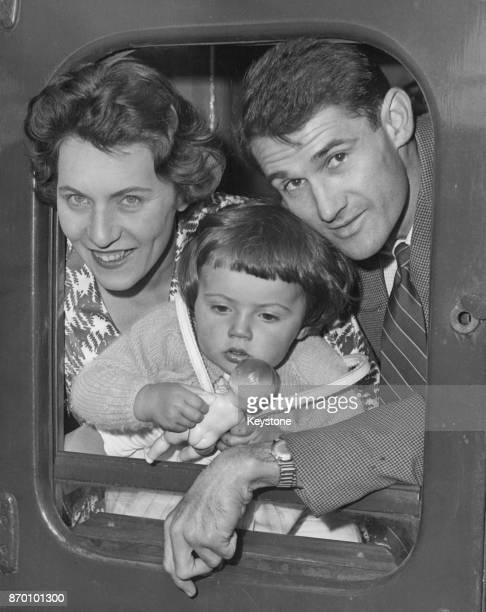 Scottish international footballer John Hewie of Charlton Athletic FC leaves Waterloo Station in London for South Africa with his wife Raye and...