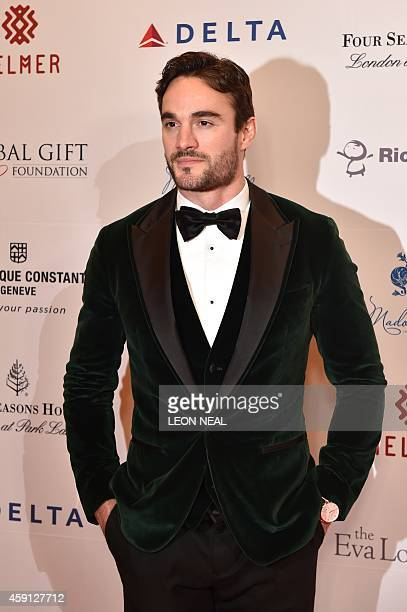 Scottish international rugby player Thom Evans poses as he arrives at the 5th annual London Global Gift Gala in London on November 17 2014 Global...