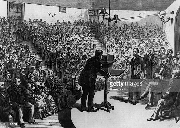 Scottish inventor Alexander Graham Bell demonstrating his telephone at the Lyceum Hall in Salem Massachusetts 15th March 1877