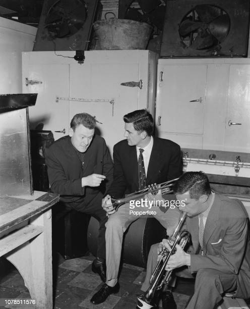 Scottish jazz drummer Bobby Orr pictured on left with jazz trumpet players Ian Hamer and Jimmy Deuchar backstage at a club in London in September 1960