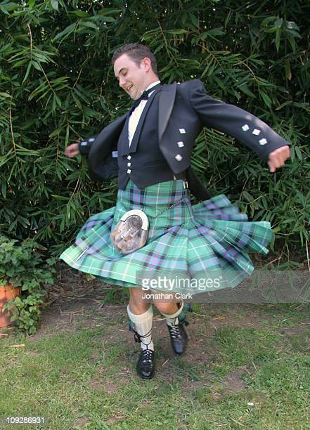 scottish kilt twirl - kilt stock photos and pictures