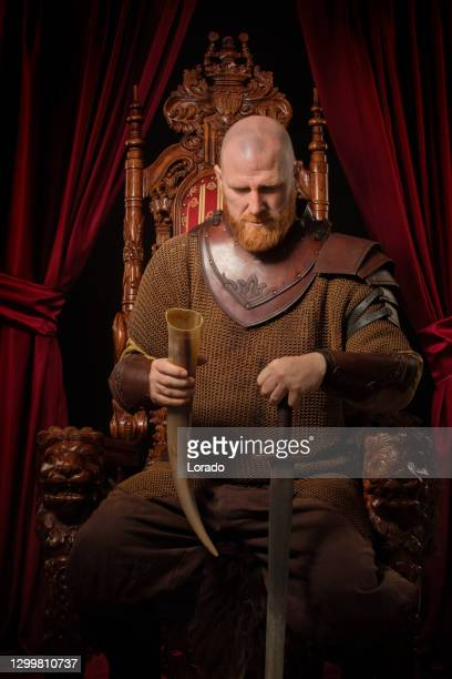 scottish king on the throne in studio shoot - king royal person stock pictures, royalty-free photos & images