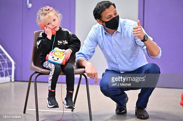 Scottish Labour leader Anas Sarwar poses for a photograph with four year old Ariah Gilliland campaigns for the Scottish Parliament election with a...