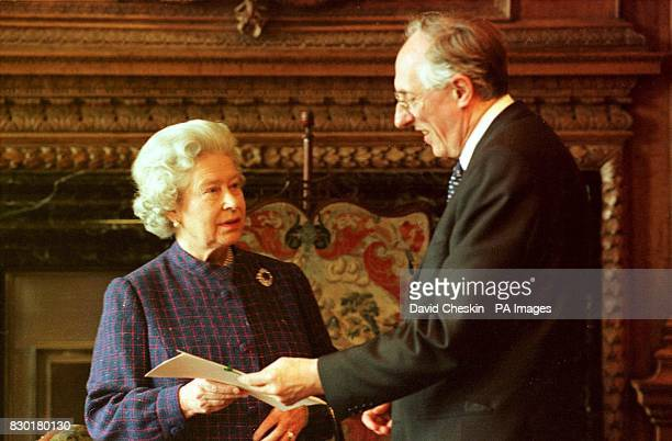 Scottish Labour leader Donald Dewar receives the royal warrant of appointment from Britain's Queen Elizabeth II at the Palace of Holyroodhouse her...