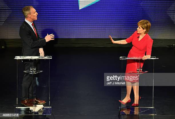 Scottish Labour leader Jim Murphy speaks as First Minister and SNP leader Nicola Sturgeon reacts during the Scottish Television Debate at the...