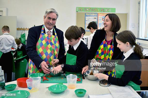 Scottish Labour leader Kezia Dugdale and Labour Opportunity Spokesperson Iain Gray help Douglas Brunton and Lauren Burnett with cooking during a...