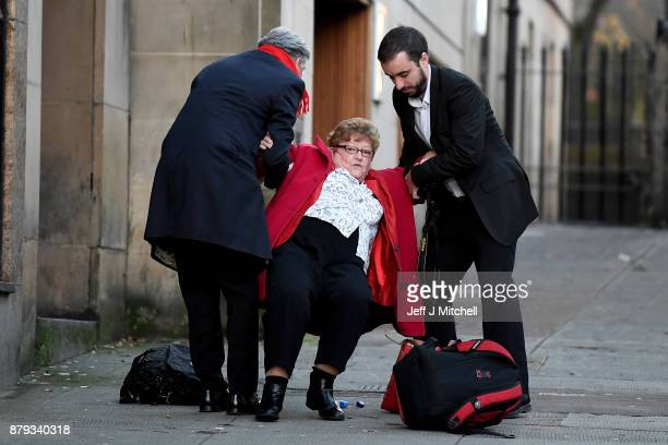 Scottish Labour leader Richard Leonard and Martin Lennon help up former MSP Cathy Peattie after she fell over as they arrive at John Smith House on...