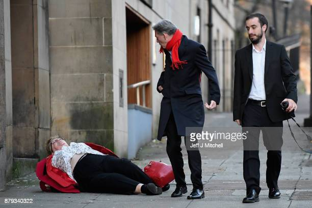 Scottish Labour leader Richard Leonard looks on as former MSP Cathy Peattie falls over as they arrive at John Smith House with Martin Lennon on...
