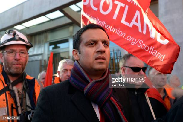 Scottish Labour leadership contender Anas Sarwar listens to speeches outside the Scottish Parliament following a march by workers from the crisishit...