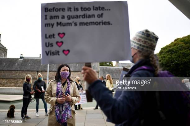 Scottish Labour MSP Monica Lennon talks to relatives as they stage a demonstration over care home coronavirus visiting rules outside the Scottish...