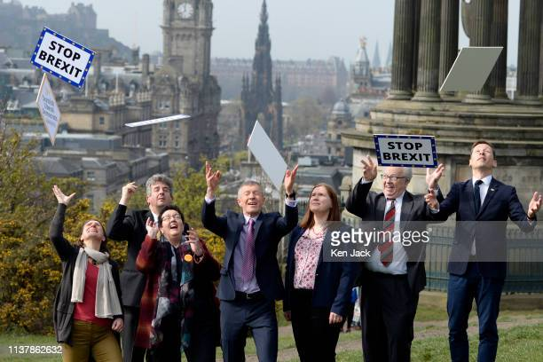 Scottish Liberal Democrat leader Willie Rennie and his party's candidates for the European elections throw up their Stop Brexit signs on Calton Hill...