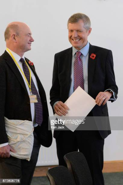 Scottish Liberal Democrat leader Willie Rennie chats with a member during the Scottish Liberal Democrats' autumn conference on November 11 2017 in...