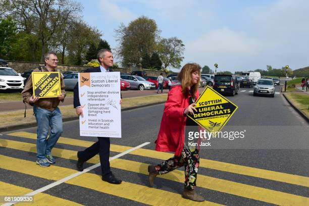 Scottish Liberal Democrat leader Willie Rennie does a Beatles Abbey Roadstyle pose as he launches a general election 'Commit Card' to be sent to...