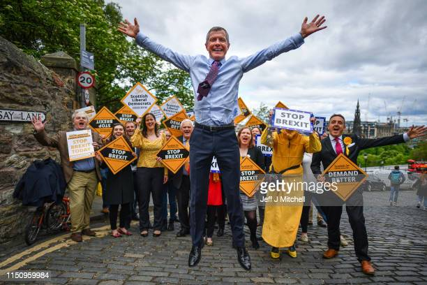 Scottish Liberal Democrat leader Willie Rennie does a star jump as he attends a rally with activists and campaigners on May 22 2019 in...