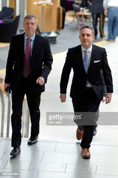 Scottish Liberal Democrat leader Willie Rennie on the way to First Minister's Questions in the Scottish Parliament accompanied Alex ColeHamilton MSP...