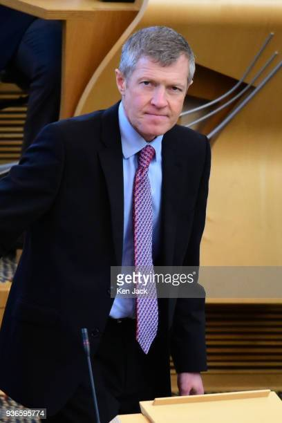 Scottish Liberal Democrat leader Willie Rennie takes his seat for First Minister's Questions in the Scottish Parliament on March 22 2018 in Edinburgh...