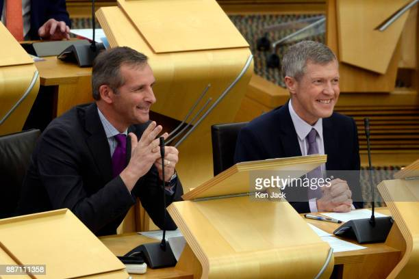 Scottish Liberal Democrat MSP Liam McArthur sits alongside party leader Willie Rennie before opening a Lib Dem debate in the Scottish Parliament...