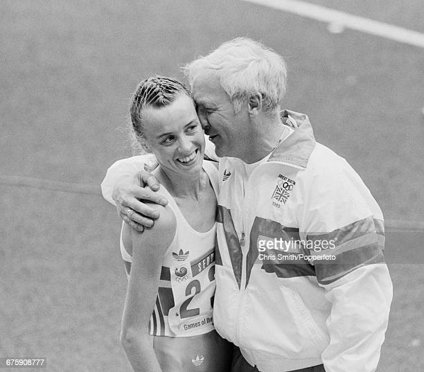 Scottish long distance track athlete Liz McColgan of the Great Britain team is congratulated by her coach John Anderson after finishing in 2nd place...