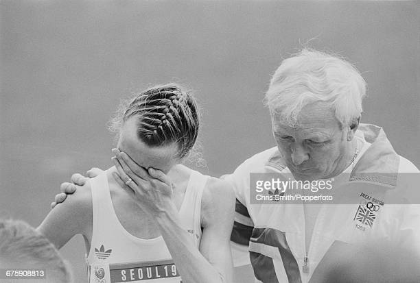 Scottish long distance track athlete Liz McColgan of the Great Britain team is comforted by her coach John Anderson after finishing in 2nd place to...