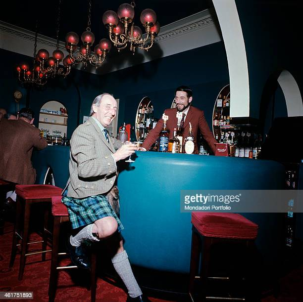 A Scottish man in kilt drinking a whisky at the bar Scotland 1971