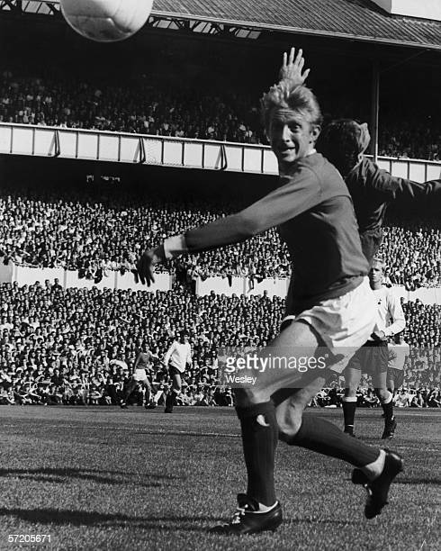 Scottish Manchester United inside left Denis Law scoring his team's first goal in a game against Tottenham Hotspur at Whilte Hart Lane 10th September...