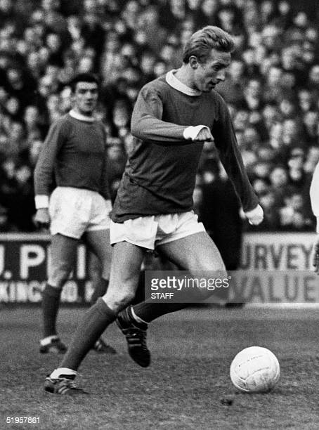 Scottish Manchester United's forward Denis Law dribbles during a Premier League soccer match 20 January 1966 in Manchester