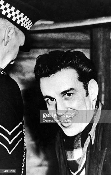 Scottish mass-murderer Peter Manuel smiling during his trial, Glasgow, Scotland, May 29, 1958.