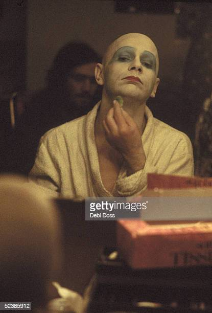 Scottish mime artist and dancer Lindsay Kemp adjusts his makeup in his dressing room during a run of the play 'Flowers' at the Bush Theatre London...
