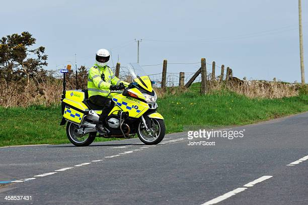 scottish motorcycle policeman on a rural road - johnfscott stock pictures, royalty-free photos & images