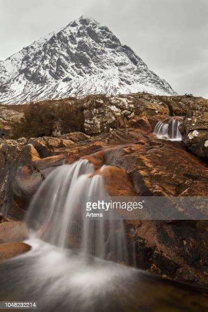 Scottish mountain Buachaille Etive Mor and waterfall on River Coupall in winter in Glen Etive near Glencoe in the Highlands of Scotland UK