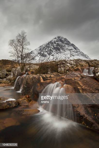 Scottish mountain Buachaille Etive Mor and waterfall on River Coupall in winter in Glen Etive near Glencoe in the Highlands of Scotland, UK.
