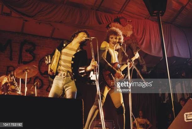 Scottish musician Alex Harvey in concert with his Soul Band including guitarist Zal Cleminson London August 1974