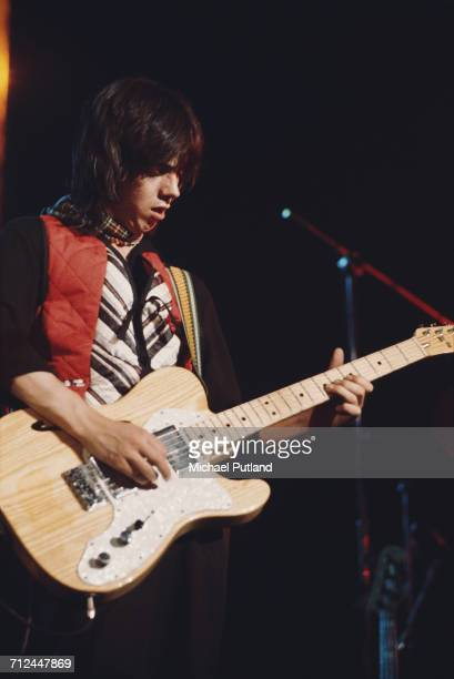 Scottish musician and guitarist Jimmy McCulloch performs live on stage with rock group Wings on their Wings Over the World tour in March 1976