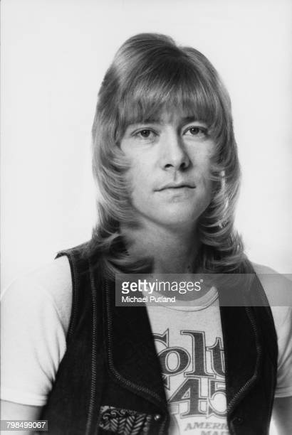 Scottish musician and lead singer Brian Connolly of British glam rock group The Sweet posed wearing a denim waistcoat and Colt 45 beer tshirt in...