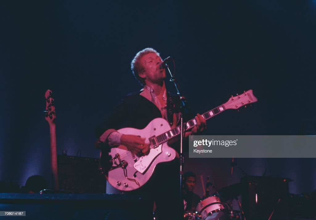 Scottish musician and singer Hamish Stuart of funk and R&B band the Average White Band (AWB) performing at the Hammersmith Odeon, London, 1977.