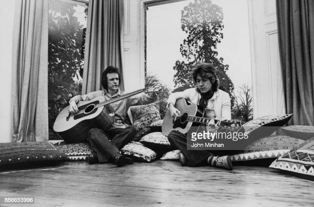 Scottish musician Jack Bruce and Mick Taylor formerly of the Rolling Stones at Bruce's home in Essex UK January 1975