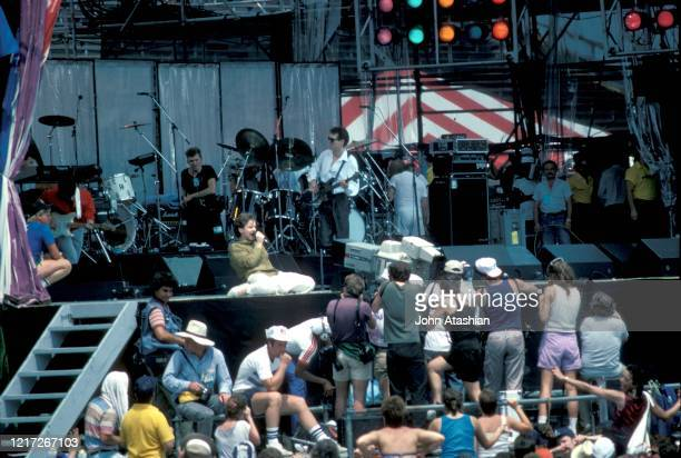 Scottish musician, singer and songwriter Jim Kerr, famous for his work with the band Simple Minds, is shown performing on stage at Live Aid on July...