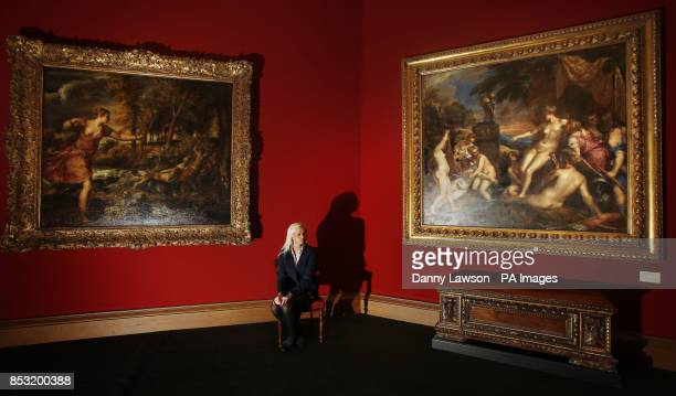 Scottish National Gallery employee Claire Pentony is sitting in front of two paintings by Titian The Death of Actaeon and Diana and Callisto which...